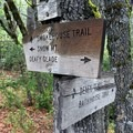 The first trail intersection at the little used Bath House Trail.- Snow Mountain via Deafy Glade