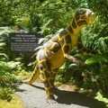 Informational signs are posted beside each of the dinosaur sculptures.- Prehistoric Gardens
