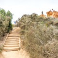 There is a staircase leading to Red Butte.- Razor Point Trail