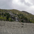 Large waterfalls run off the cliffs along the trail, especially during the spring season.- Morteratsch Glacier Walk
