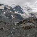 The rock outcrop behind which the Morteratsch Glacier has mostly retreated.- Morteratsch Glacier Walk