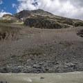 Munt Pers seen on the left side of the trail across the glacial river Ova da Morteratsch.- Morteratsch Glacier Walk