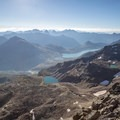 From Munt Pers you can see past the Lago Bianco and, on a clear day, into Italy.- Diavolezza, Munt Pers + Sass Queder Hike