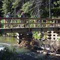 Bridge over Swiftcurrent Creek.- Grinnell Lake Overlook