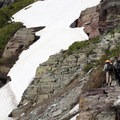 Snow hazards can linger on the trail into July. For individuals unfamiliar with (or unprepared for) snowfield crossings, this is your turn-around point.- Grinnell Lake Overlook