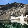 Crystal Lake is punctuated by a historic dam and has breathtaking peaks surrounding its entirety.- Crystal Lake