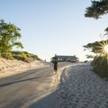 Walking toward the historic beach house.- Ludington State Park