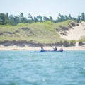 Sit-on-top kayaks are popular on the lake.- Lake Michigan Paddling: Ludington State Park Beach House to Big Sable Point Lighthouse