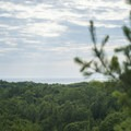 A distant view of Lake Michigan.- Lake Michigan Recreation Area + Nordhouse Dunes Wilderness Area