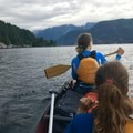 Crossing via the western shore. Lots of watefront houses to pass. - Paddle to Twin Islands Campsite