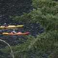 Kayakers make their way past on a day trip from Deep Cove. - Paddle to Twin Islands Campsite