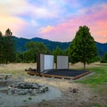 An amphitheater for programming between D and F loops - pictured here beneath a wildfire smoky sky.- Valley of the Rogue State Park Campground