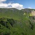 The Bachläger waterfall and First Cliff Walk seen from the road near Waldspitz.- Grindelwald to First