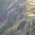 Waterfalls along the hillside.- Grindelwald to First