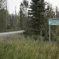 Entrance to the access road from the Alaska Highway.- Smith River Falls