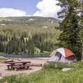 Lakeside campsite at Lake Irwin.- Lake Irwin Campground