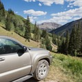 Four-wheel drive trailhead with Sunshine Mountain in the background.- Matterhorn Peak