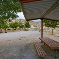 Each site has a covered bench and a fire ring.- Westside Campground