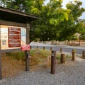 A self-pay station and information board are in the central camp area.- Westside Campground