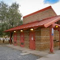 A central bathroom building with water and showers serves Westside Campground.- Westside Campground