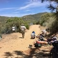 Thru-hikers resting next to a water source.- Pacific Crest Trail: California Section B
