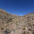 Historic Babylon Trail passes through rocky, open desert.- Historic Babylon Trail