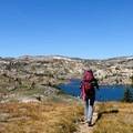 Hiking on the Beartooth Plateau is truly a unique experience. Pictured here is the view over Fizzle Lake. - The Beaten Path