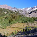 The user trail to Arrowhead Lake crosses Scott Spring below North Sister and Middle Sister.- Middle Sister: West Approach