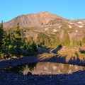 A portion of Arrowhead Lake in late season below North Sister.- Middle Sister: West Approach