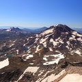View to the south of South Sister (right), Broken Top, and Bachelor in the distance.- Middle Sister: West Approach
