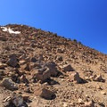 Looking back on the rocky scree field on descent from the summit.- Middle Sister: West Approach