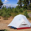Typical campsite near the shore of Arrowhead Lake with the Cascades to the north in the background.- Middle Sister: West Approach