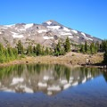 Middle Sister reflected in Arrowhead Lake.- Middle Sister: West Approach