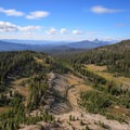 The headwaters of Glacier Creek from the Arrowhead Lake bluff.- Middle Sister: West Approach