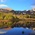 North Sister and Middle Sister reflected in Arrowhead Lake.- Middle Sister: West Approach