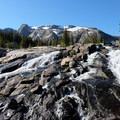 Splendid cascade of water from Dewey Lake.- The Beaten Path