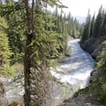 Just down the trail you will get a superb view of the Bow picking up speed. - Bow Peak via Crowfoot Glades