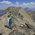 The summit draws near. Just a few more stones to hop. - Bow Peak via Crowfoot Glades