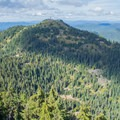 Views from Bohemia Mountain include the Lookout Tower on Fairview Peak as well as the old ghost town below. - Bohemia Mountain Trail