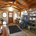 The common kitchen area, along with outdoor grills, allows guests to prepare their own food.- Out'N'About Treehouse Resort