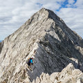 Ascending the Knife Ridge with Capitol Peak in the background.- Capitol Peak