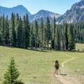 Hiking the Capitol Creek Trail to camp.- Capitol Peak