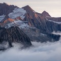 Wannenhorn and Strahlhorn catching the morning light beautifully with a cloud inversion.- Fiescheralp to Eggishorn Hike