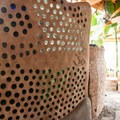 Earthship's structure includes recycled glass bottles.- Earthship Patagonia Hostel