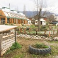View from entrance looking at the compost, earthship, and yurts.- Earthship Patagonia Hostel