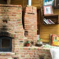 Inside the earthship. An area to sit at the fire and read a book.- Earthship Patagonia Hostel