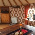 Inside the communal yurt where breakfast is served.- Earthship Patagonia Hostel