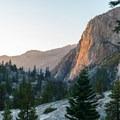 The last rays of light casting a fiery glow on the granite cliffs.- Glen Aulin High Sierra Camp to Waterwheel Falls