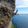 It is at least a V3 traverse to make it the whole way. Be prepared to swim. - Coasteering on Sangster Island