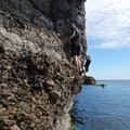 Just past the seal cave is the crux. It is a tricky overhung section that is plenty deep at high tide. - Coasteering on Sangster Island